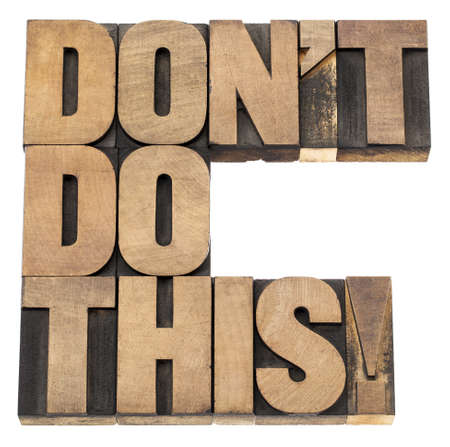 do not do this warning -  isolated text in vintage letterpress wood type printing blocks Stock Photo - 17806557