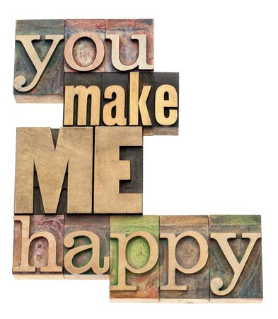relationship love: you make me happy - isolated text in vintage letterpress wood type printing blocks Stock Photo