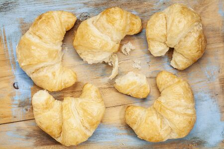 croissant rolls on a grunge painted wood board Stock Photo - 17806563