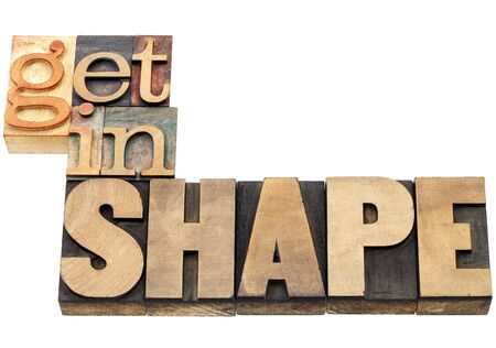 get in shape - fitness concept - isolated text  in vintage letterpress wood type Stock Photo - 17806572