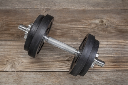 exercise weights - iron dumbbell on a wooden deck Stock Photo - 17959945