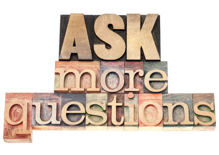 ask more questions - isolated text in vintage letterpress wood type printing blocks Stock Photo - 17959951