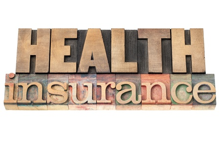 health insurance: health insurance - healthcare concept - isolated text in vintage letterpress wood type printing blocks