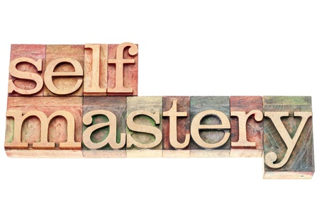 mastery: selfmastery word - isolated text in vintage letterpress wood type printing blocks Stock Photo