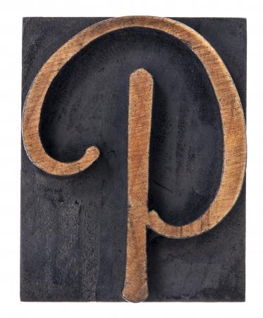 wooden block letter: ornamental letter P - script font - isolated letterpress wood type printing block