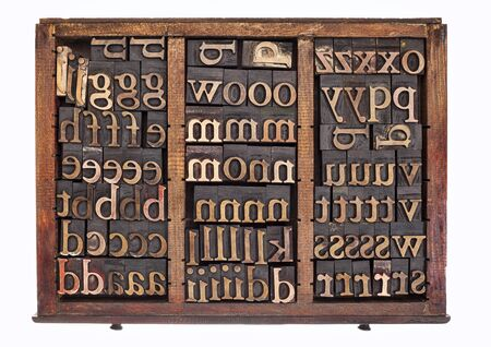 typesetter: letterpress wood type printing blocks in old typesetter drawer isolated on white Stock Photo
