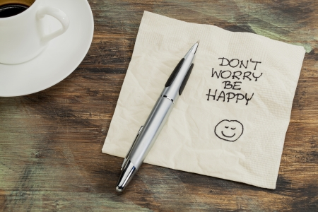dont worry: Dont worry be happy - a cocktail napkin doodle with cup of coffee Stock Photo