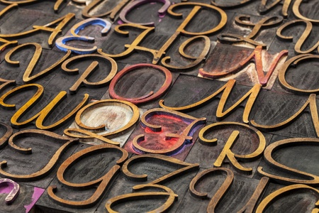 alphabet abstract in script font letterpress wood type printing blocks stained by inks Stock Photo - 18025574