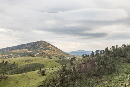 fort collins: hiking trail in Horsetooth Mountain Park, residential houses and Rocky Mountains, Fort Collins, Colorado - springtime scenery Stock Photo