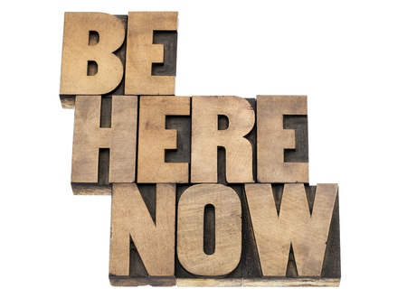 be here now  - motivational and spiritual reminder- isolated text in vintage letterpress wood type printing blocks Stock Photo - 18083301