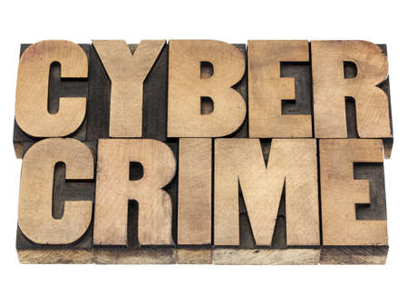 cyber crime: cyber crime - isolated text in vintage letterpress wood type printing blocks Stock Photo