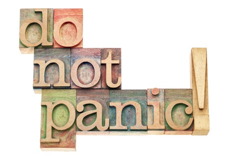 do not panic  warning - isolated text in vintage letterpress wood type printing blocks Stock Photo - 18083299