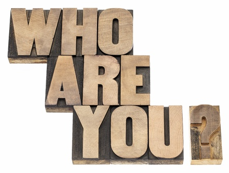 Who are you question - isolated text in vintage letterpress wood type printing blocks Stock Photo - 18083302