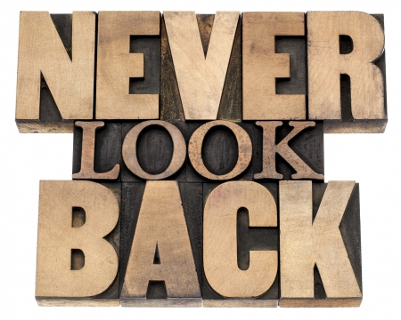 retrospective: never look back phrase - isolated text in vintage letterpress wood type printing blocks, a variety of fonts