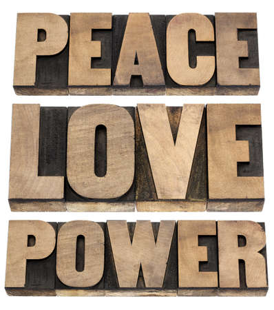 peace, love, power words - isolated text in vintage letterpress wood type printing blocks Stock Photo - 18083315