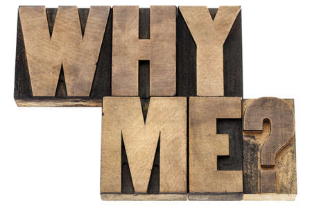 Why me question - isolated text in vintage letterpress wood type printing blocks