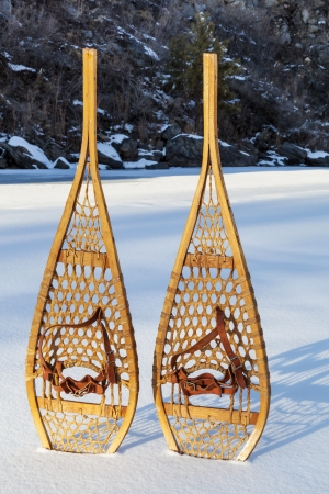 vintage wooden Huron snowshoes with leather binding in snow Stock Photo - 18133758