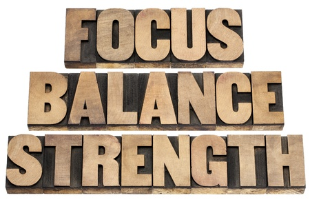 focus, balance, strength  - performance concept - isolated text in letterpress wood type printing blocks Stock Photo - 18169264