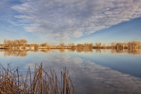 calm lake with cloud reflection - Arapaho Bend Natural Area in Fort Collins, Colorado Stock Photo - 18223998