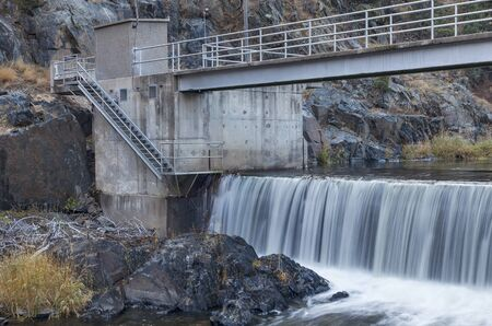 weir: diversion dam on Big Thompson RIver in Rocky Mountains near Loveland, Colorado Stock Photo