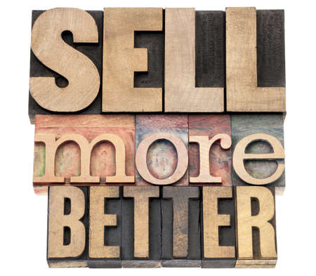 sell more better -  isolated text in letterpress wood type printing blocks Stock Photo - 18223979