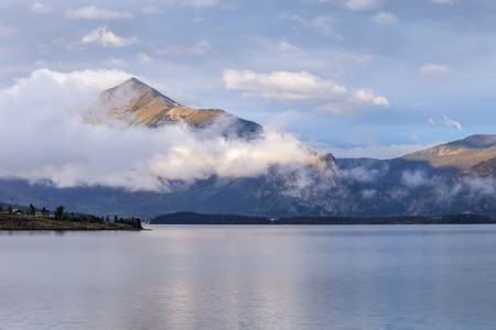 lake dillon: morning fog rising over calm Lake Dillon in Colorado Rocky Mountains Stock Photo