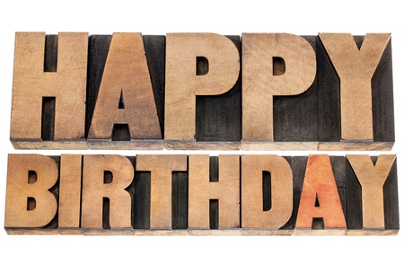 happy birthday - isolated text in letterpress wood type printing blocks Stock Photo - 18286916
