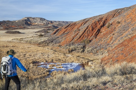 male hiker with a backpack in a rugged Colorado landscape - Red Mountain Open Space near Fort Collins Stock Photo - 18286072
