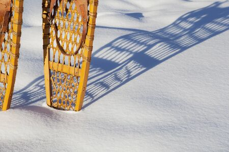 shadow of vintage Bear Paw snowshoes in snow Stock Photo - 18286914
