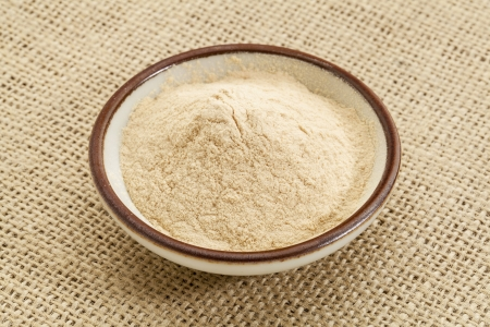small ceramic bowl of African baobab fruit powder against burlap canvas Stock Photo - 18363740