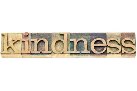 wood type: kindness  - isolated word in vintage letterpress wood type printing blocks Stock Photo