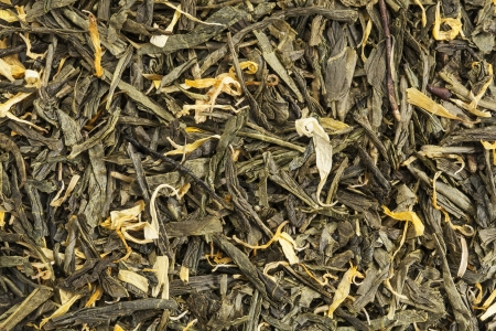 background texture of loose leaf green tea with calendula and marigold petals Stock Photo - 18413683