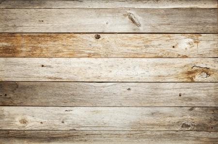 素朴な風化の納屋の木材ノットと背景し、爪の穴