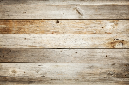rustic weathered barn wood background with knots and nail holes photo