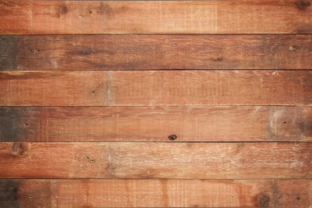 red weathered barn wood background with knots and nail holes photo