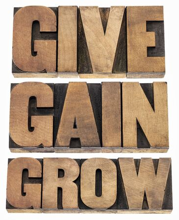 give, gain and grow -personal development or motivational concept - isolated word in vintage letterpress wood type printing blocks Stock Photo - 18517346