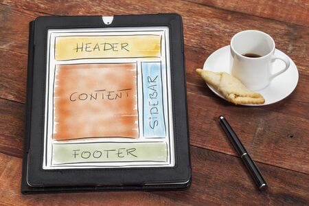 designing website layout on digital tablet computer with a cup of coffee, cookie and stylus pen Stock Photo - 18517377