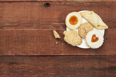 plate of assorted cookies with crumbs  on a rustic red barn wood table Stock Photo - 18589721