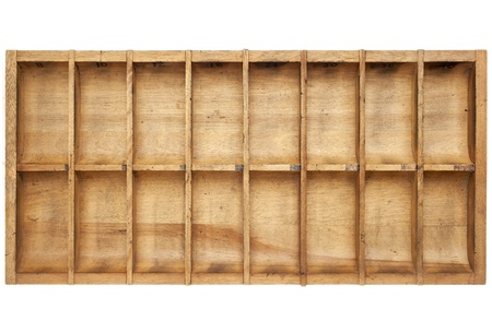 typesetter: vintage wood typesetter box with 16 numbered bins isolated on white