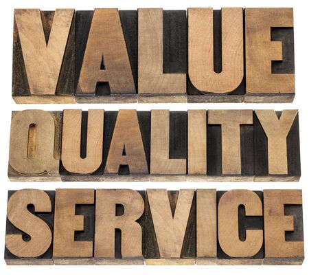 value, quality, service- business mantra concept - isolated words in vintage letterpress wood type printing blocks 版權商用圖片