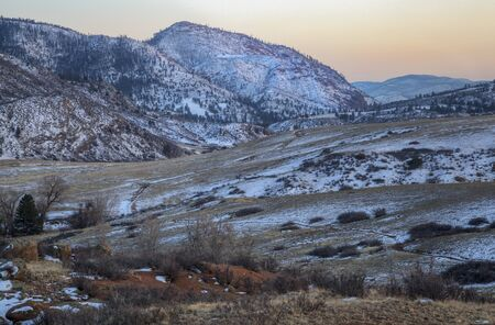 eagle nest rock: winter dusk at mountain valley of North Fork Cache la Poudre River in northern Colorado