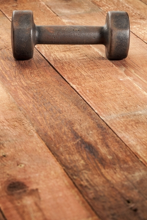 vintage iron rusty dumbbells on weathered red barn wood background - fitness concept Stock Photo - 18792194