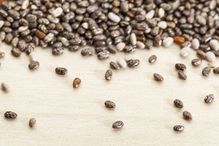 chia seed: chia seeds  on poplar wood surface -  a close-up with a shallow depth of field Stock Photo