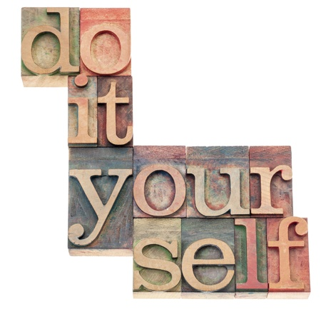 do it yourself: do it yourself, popular culture phrase - isolated text in vintage letterpress wood type printing blocks