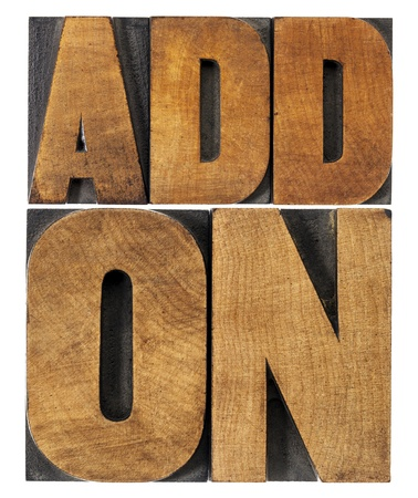 printing block: addon (add-on)- computer software component or application - isolated text in vintage letterpress wood type printing blocks