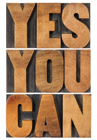 printing block block: Yes you can - motivational slogan - isolated text in vintage letterpress wood type printing block, rectangular layout Stock Photo