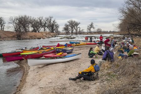 evans: SOUTH PLATTE RIVER, EVANS, COLORADO - APRIL 6: Paddlers are taking a lunch break during Annual All Club Paddle on April 6, 2013. It is a popular season opening paddling trip in northern Colorado.