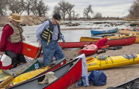SOUTH PLATTE RIVER, EVANS, COLORADO - APRIL 6: Paddlers are taking a lunch break during Annual All Club Paddle on April 6, 2013. It is a popular season opening paddling trip in northern Colorado.
