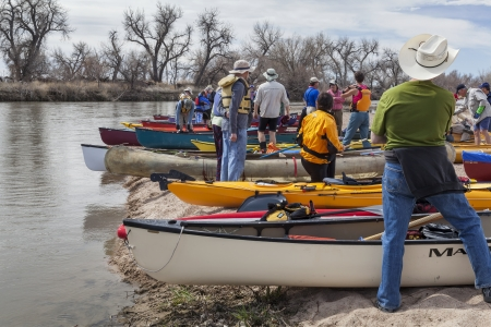 SOUTH PLATTE RIVER, EVANS, COLORADO - APRIL 6: Preparing kayaks and canoes for a launch during Annual All Club Paddle on April 6, 2013. It is a popular season opening paddling trip in northern Colorado.