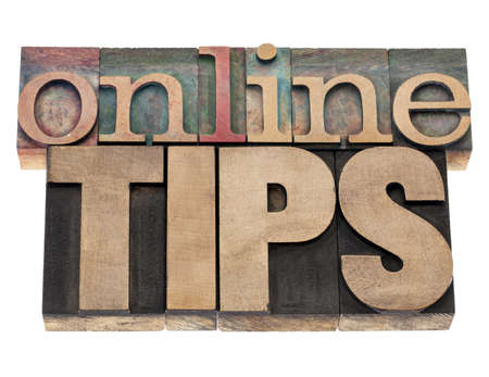 printing block: online tips - internet help concept - isolated text in vintage letterpress wood type printing blocks